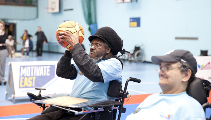 Two men playing wheelchair basketball