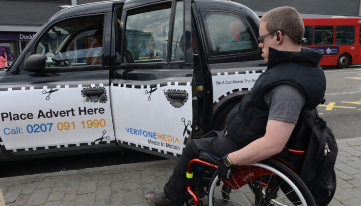 Wheelchair user about to get into a London taxi