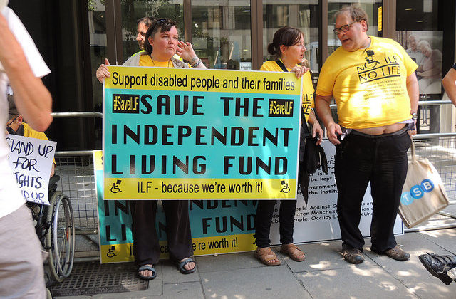 Group holding a Save the Independent Living Fund banner
