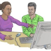 Woman in purple top points at a computer screen. She is sitting next to a man in a green shirt.