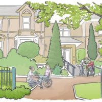 Residential Home with people in the garden in front