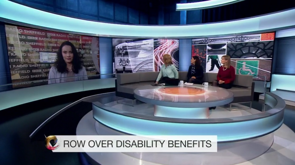 Alice Kirby speaking to Victoria Derbyshire on BBC TV, with a headline reading 'Row Over Disability Benefits'