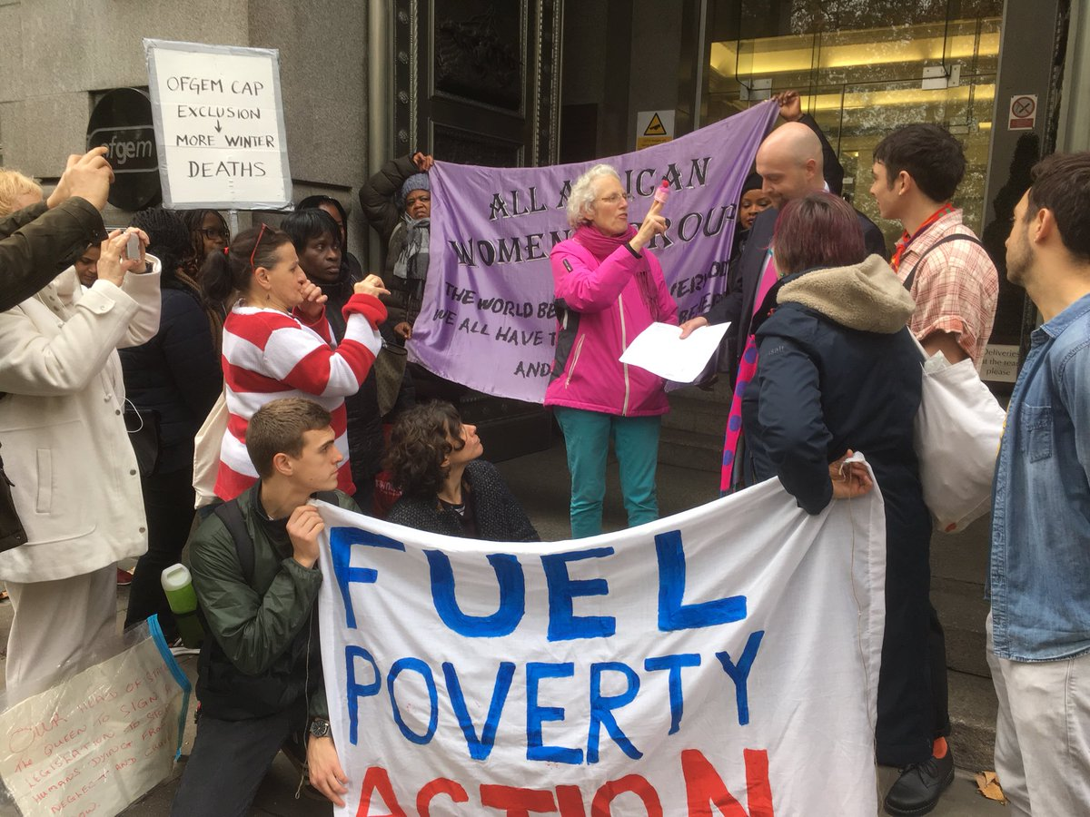 Protestors with a banner which sys FUEL POVERTY ACTION